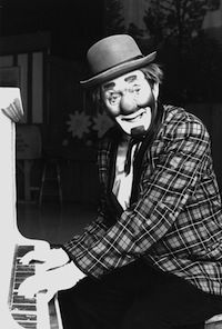 clown playing piano